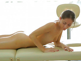 Lustful babe with well-shaped ass gets a full body massage