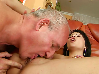 Sweet brunette whore gives an old man a nice blowjob