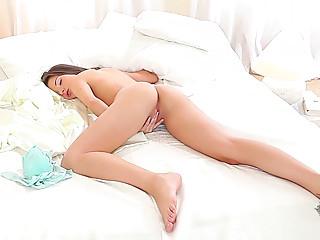 Yet sleepy but already horny brunette is ready to tickle her wet pussy