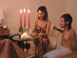 Amateur couple celebrating anniversary by the candlelight