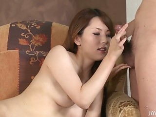 Petite milk skinned nympho Yui Hatano gives blowjob on the couch