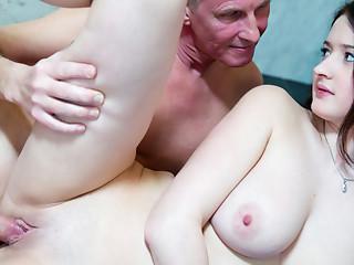 Old man strokes big jugged gal in the bathroom
