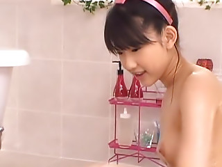 Fresh Asian model enjoys giving her boyfriend a wet massage in the bath