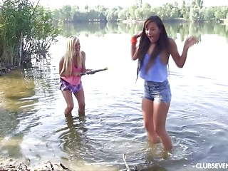 Juicy babes splashing in the lake and eating cookie on the shore