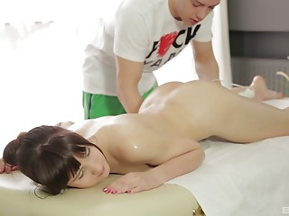 Masseur makes this oiled up young slut lewd as hell for his dick
