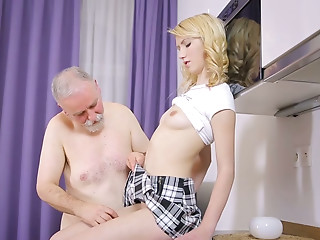 Hot coed Helena receives her cum-hole eaten out on the kitchen counter