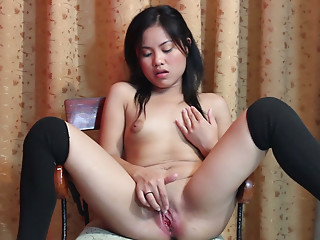Marvelous cutie with narrow eyes masturbates with a fake penis