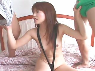 Dark haired horny Japanese slut happily sucks two dicks at once for semen